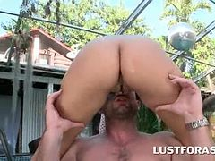 Sweet ass bitch deep throating cock by the pool