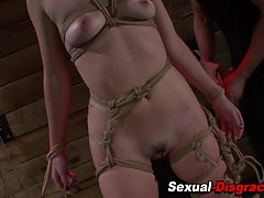 Bound slave fingered and toyed